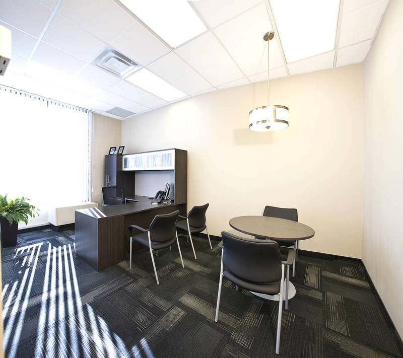 Black chairs and wood tables in executive office area