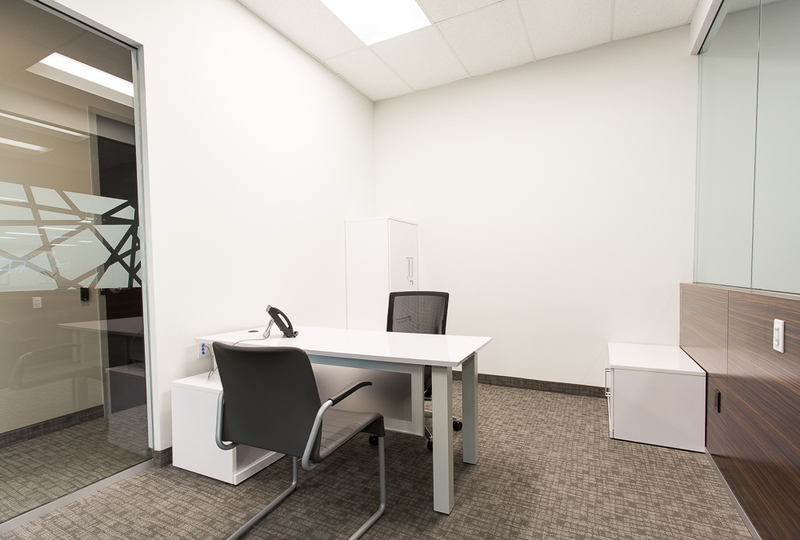 White table and dark chairs in an executive office