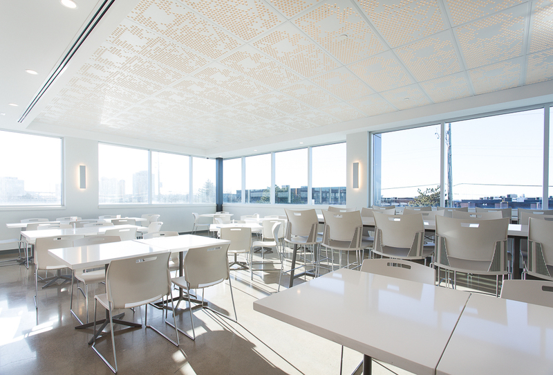 White tables and chairs in an office lunchroom