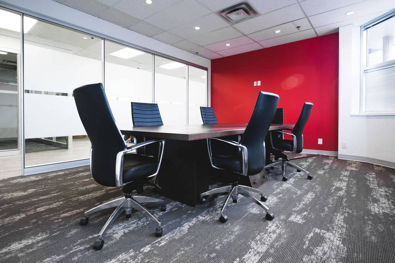 Black chairs and wood table in a business meeting room