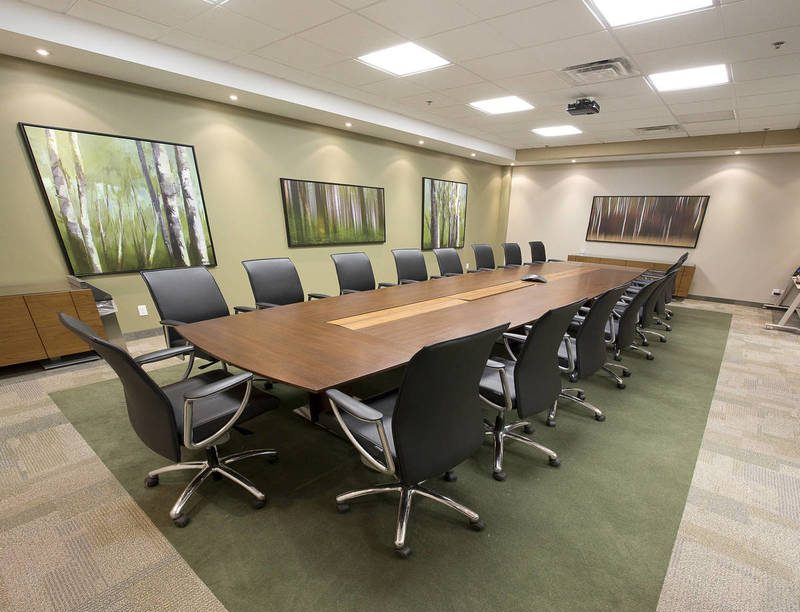 Long wooden table in meeting room at a office